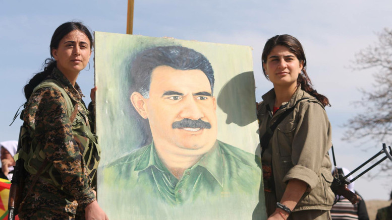 Sinjar Resistance - PKK hold up Ocalan portrait-777x437